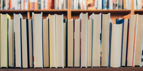 Row of books with spine down on the shelf