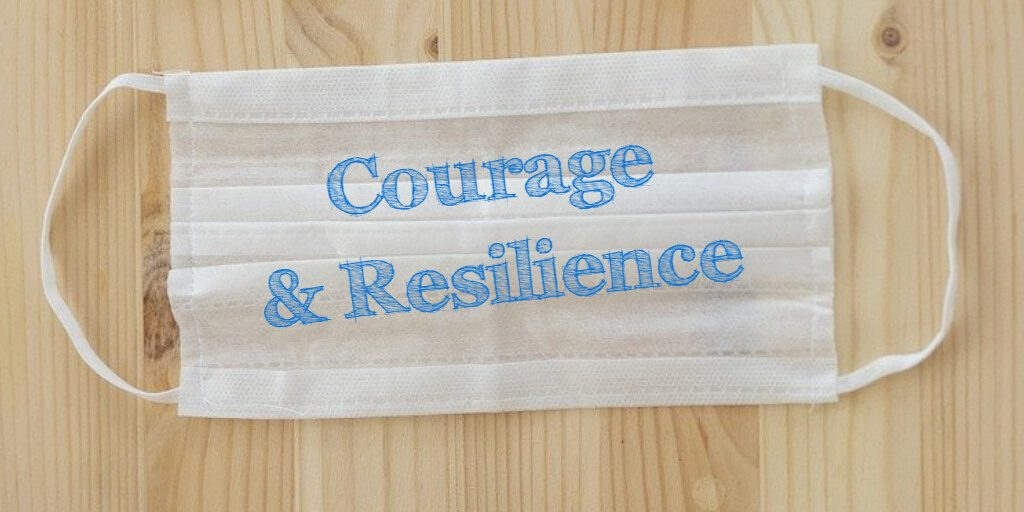The words Courage and Resilience printed in blue on a white face mask