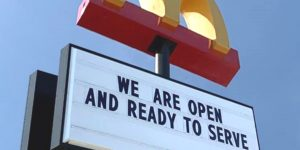 McDonald's sign stating we are open and ready to serve