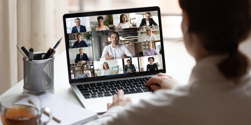 Woman seated at her laptop participating in a virtual meeting