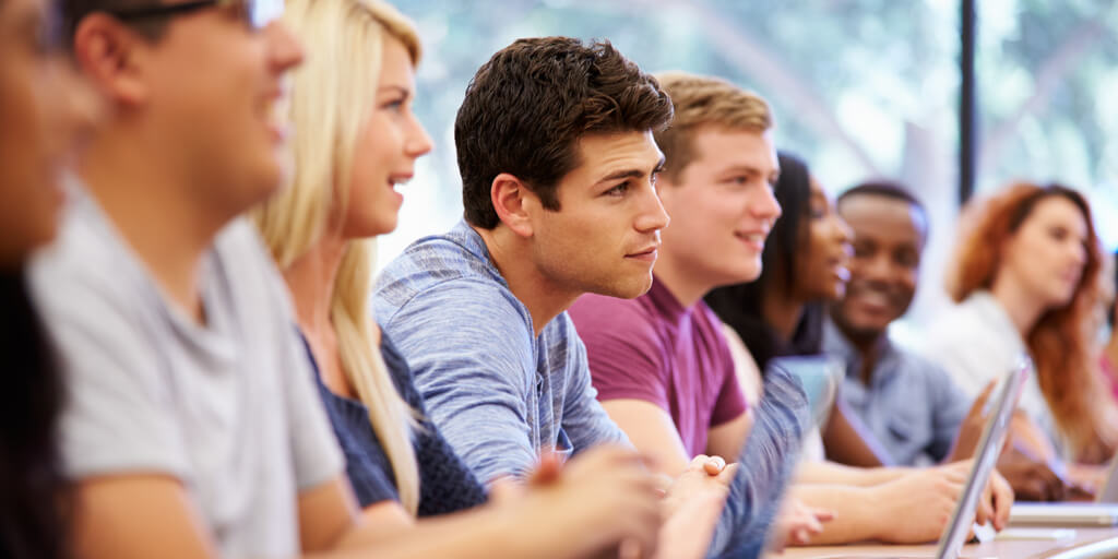Attentive college students listening to instructor