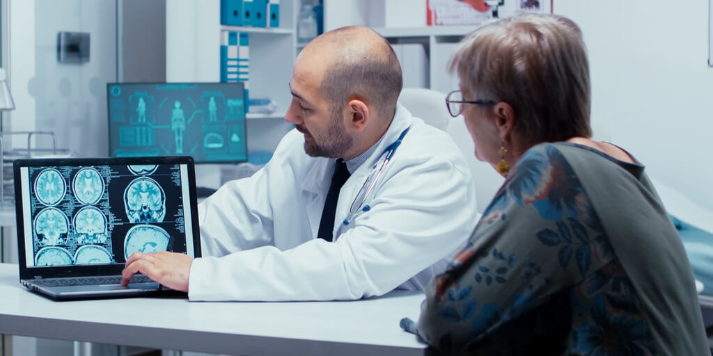 Doctor consulting with Patient using Technology