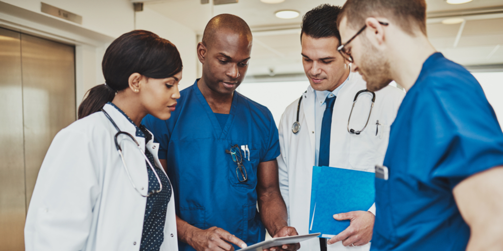 Doctors looking at file thinking and discussing options