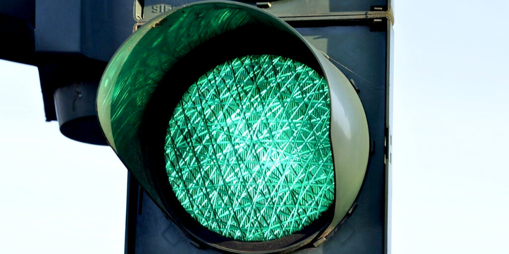Green traffic light representing change