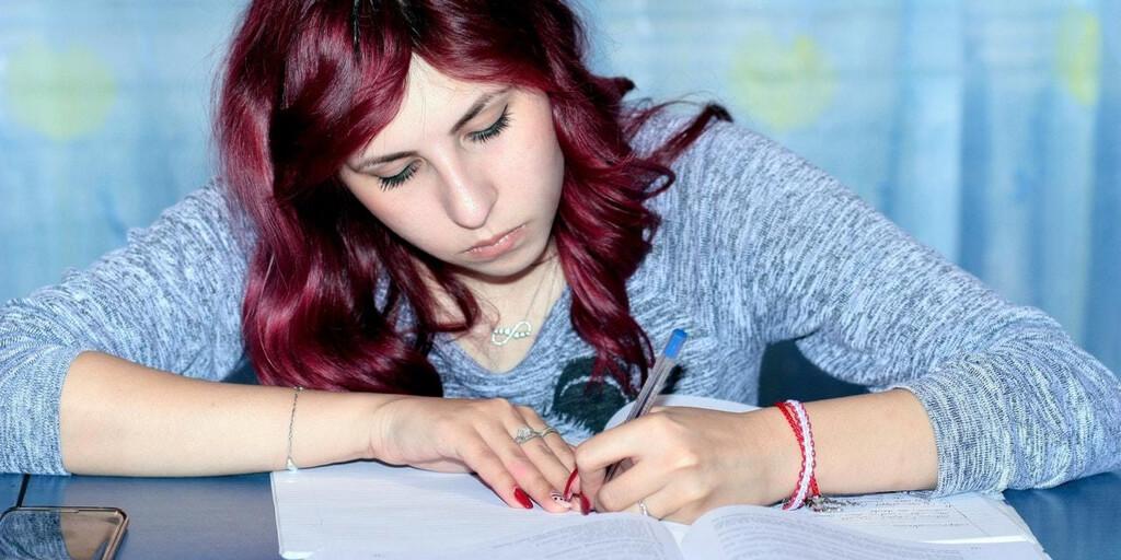 High School girl writing in notebook