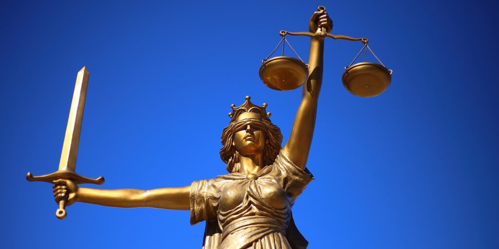Lady Justice against a blue sky