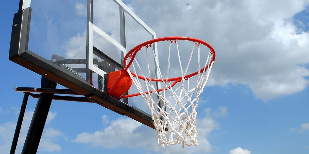 Basket ball hoop against blue sky