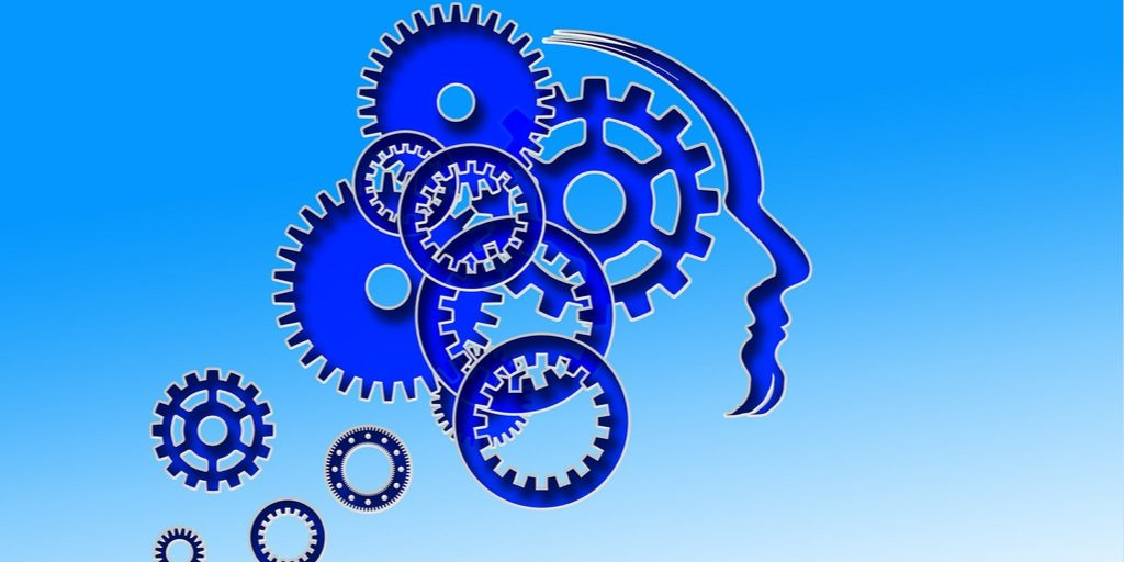 Image of spinning blue gears representing critical thinking