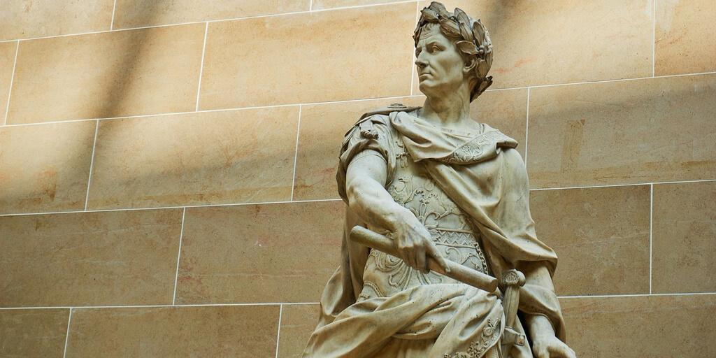 Statue of Julius Caesar wearing laurel wreath on head