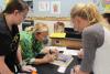 Science teacher explaining dissection