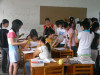 Students working in small groups in a classroom